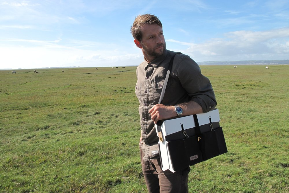 Andrew carries the Onja stove packed up neatly like a messenger bag