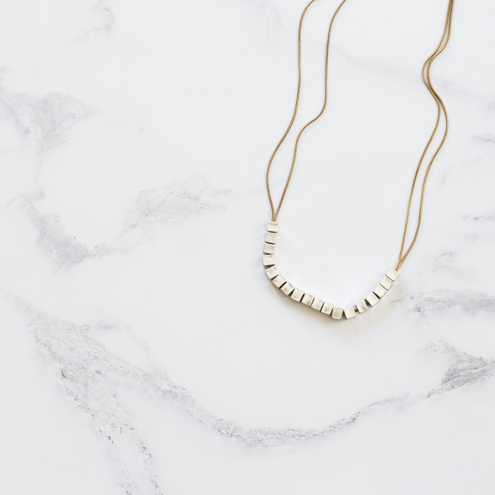 Necklace on Marble Photo Board.jpg