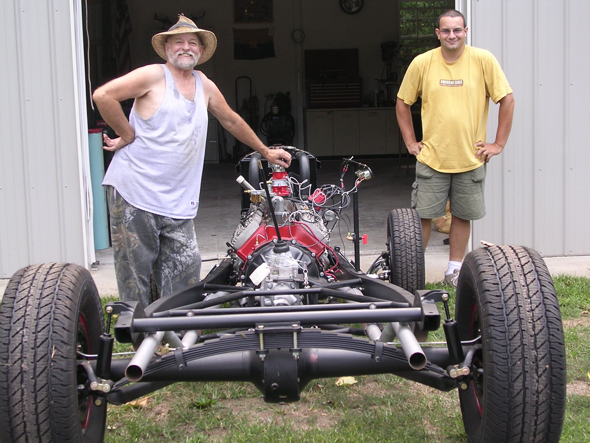 sean and dad posing with teh chassis.