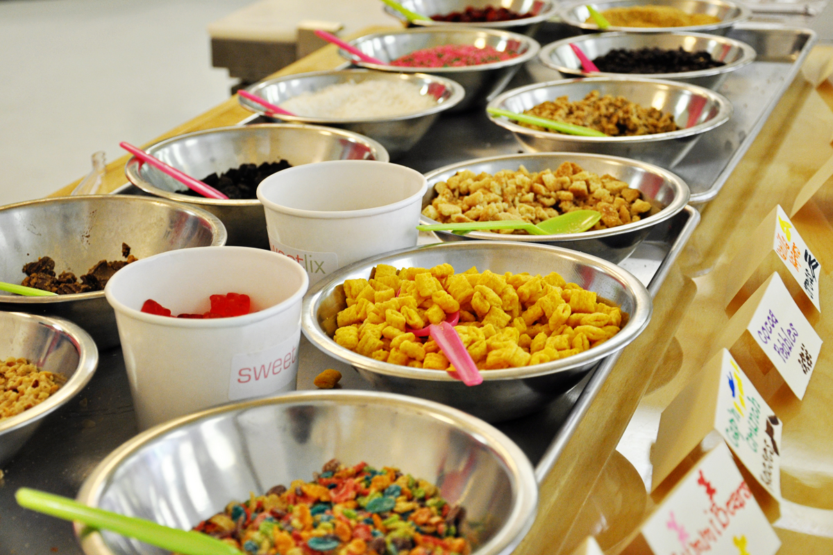 Cap'n Crunch, granola, fresh fruit, chocolate chips, gummy bears... you name it and it's on their toppings bar.