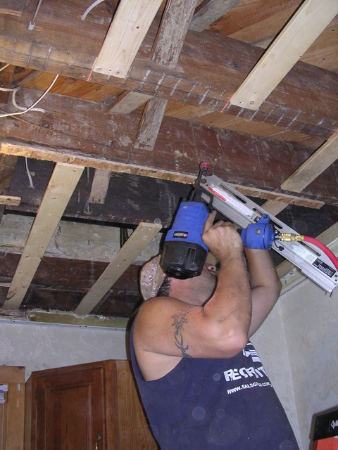 he's got mad handyman skills and looks wicked hot in a sleeveless t-shirt.