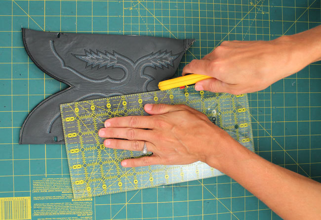 "9. Use the ruler and rotary cutter to cut a 2"" by 4"" rectangle out of the back piece of the boot."