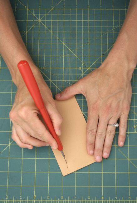 3. Use utility knife (and ruler if necessary) to cut out the pattern you have traced on the leather.