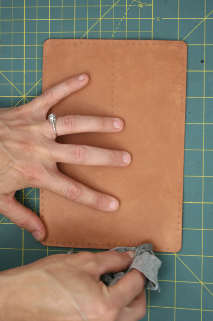 6. Wipe excess away with a soft cloth. Use the cloth to rub the edges of the leather. This will create a nice, smooth edge.