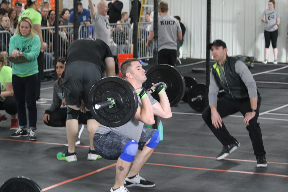 Team member Keaton on the barbell in WOD 1.  Photo Credit: The Beardsleys