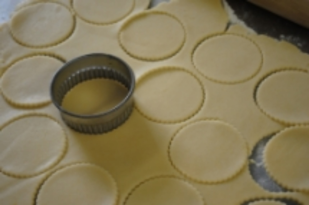 Roll thin, about an 1/8th of an inch. Place on a cookie sheet. Bake at 350 degrees for 8 minutes.