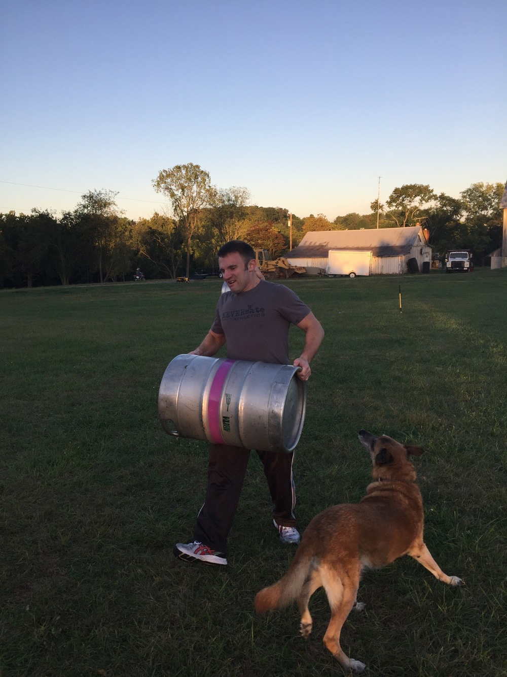 "Ryan & our 4 Legged athlete ""Laura"" Getting after some keg carries..."