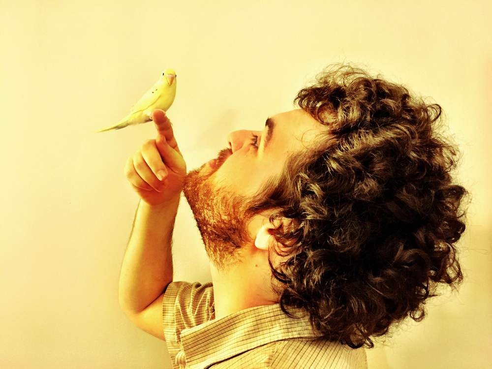 Louis and his bird.