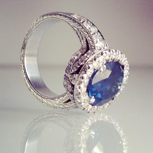 Bespoke Hand engraved 6 and a half carat sapphire and diamond ring in white gold.jpg