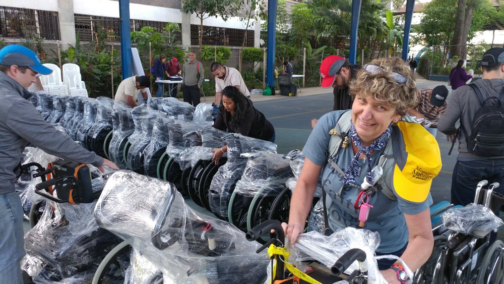 Our own Terri Demar unwrapping re-manufactured wheelchairs for distribution in Guatemala City, August 2017.