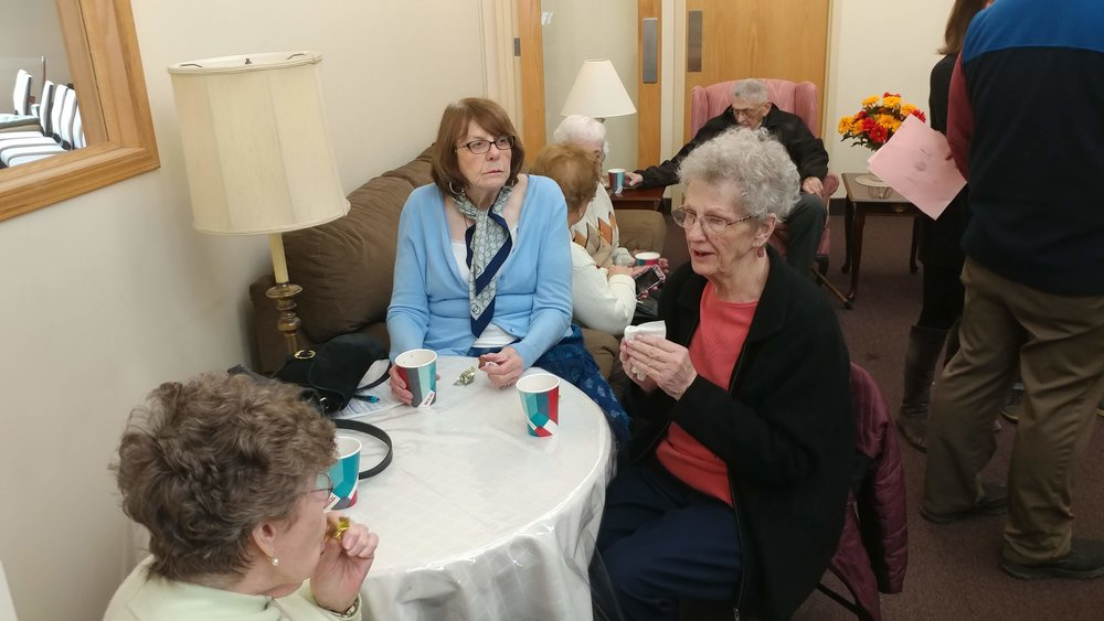 Peggy, Kathy, and Pat enjoying each other's company and a cup of coffee after worship. Join us!