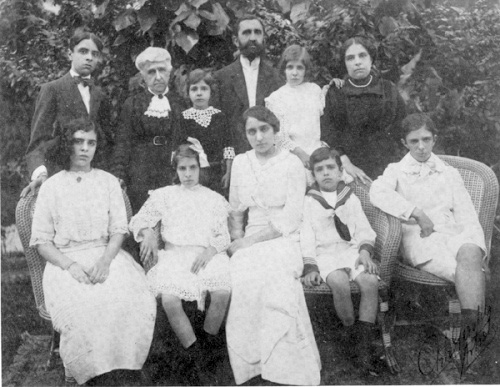 The village's founder John Street surrounded by his family. Circa 1915