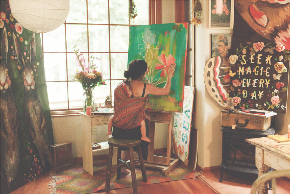 Katie in her studio with her son, Finn