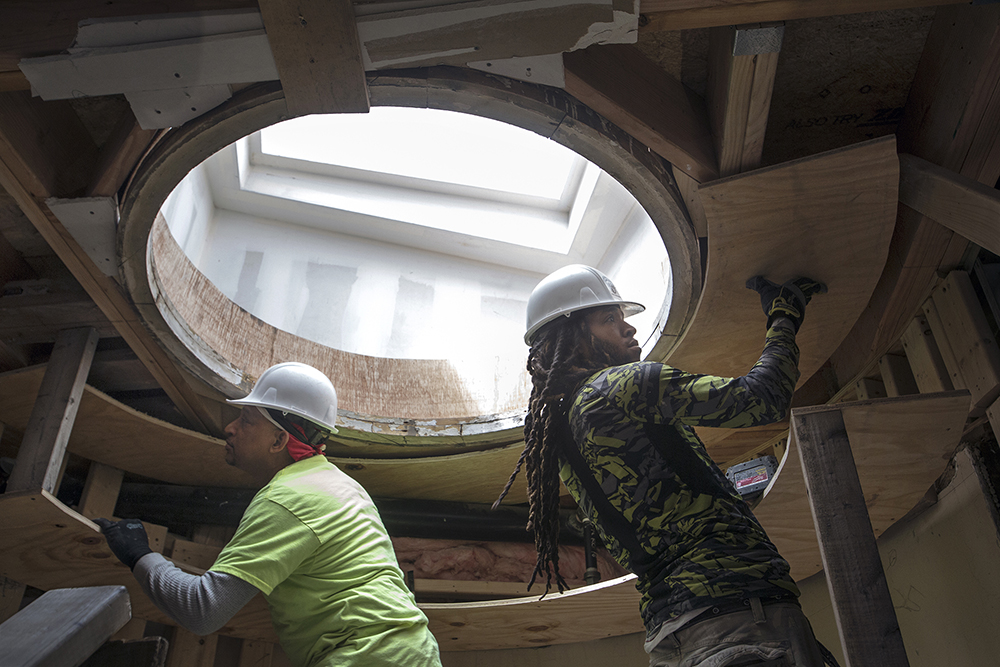 Installing skylight, USA Workers.jpg