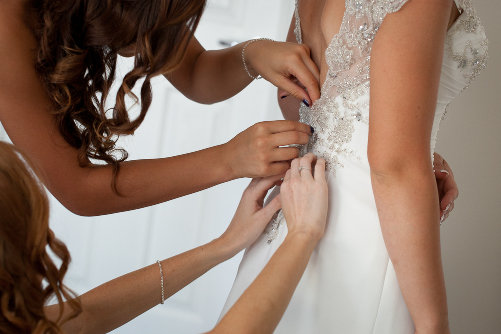 Tying up the wedding dress.