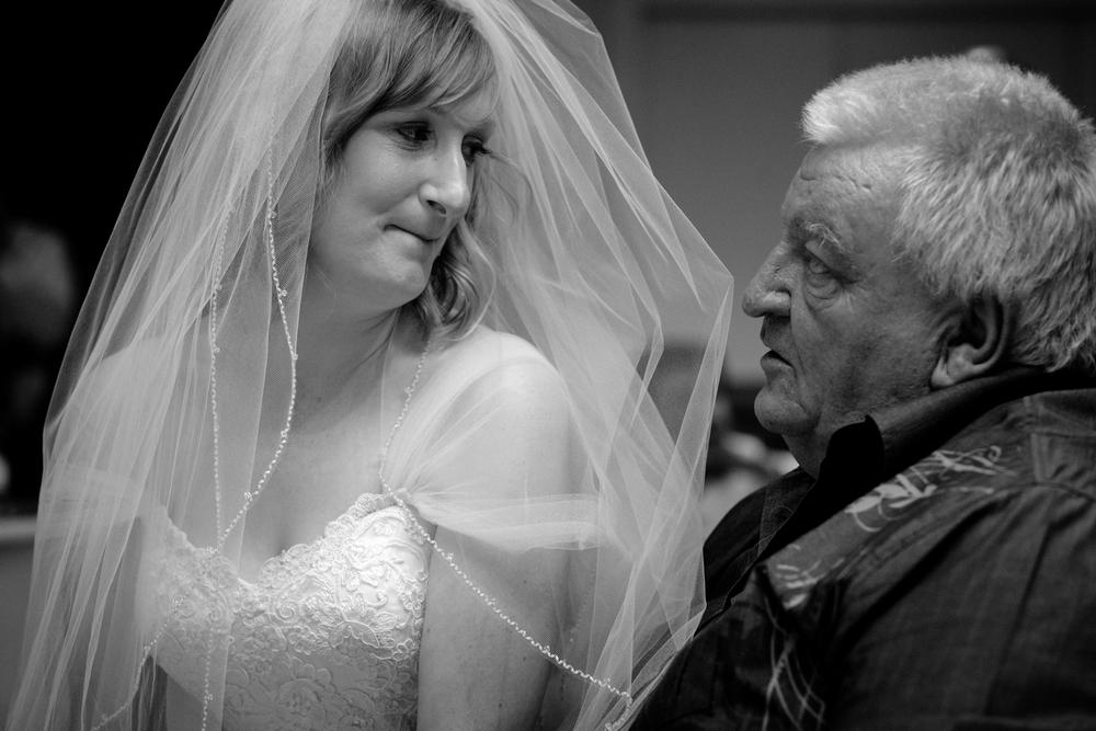 bride-sitting-on-guests-lap.jpg