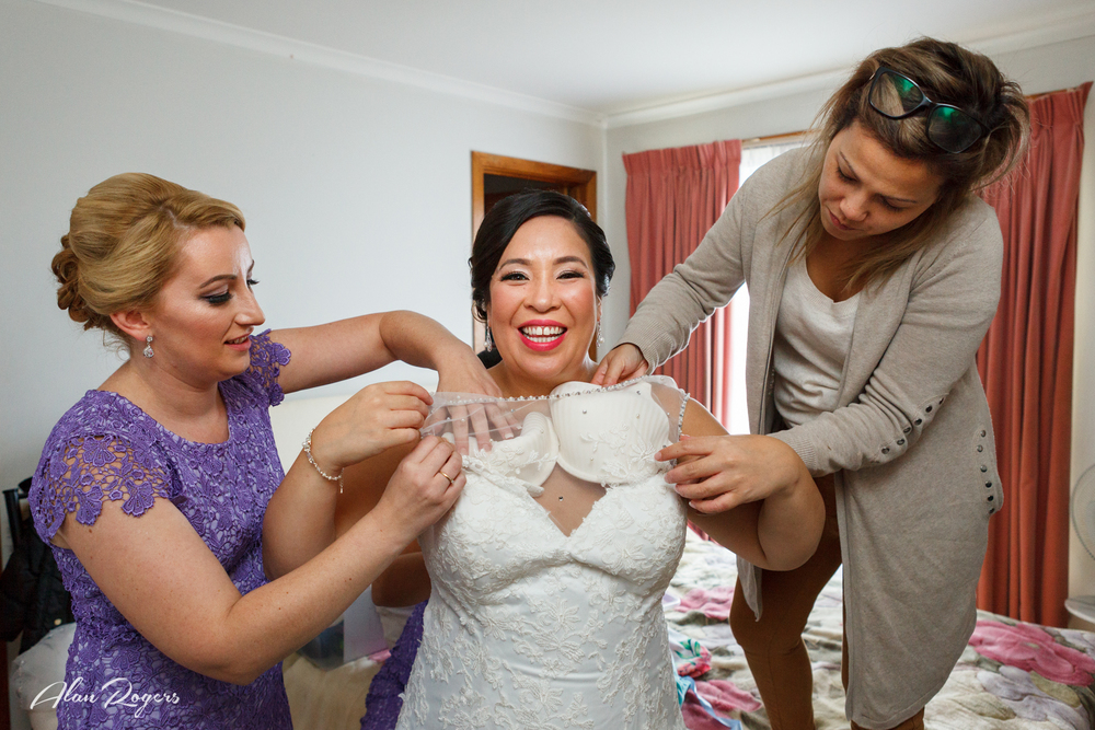 Helping the bride.
