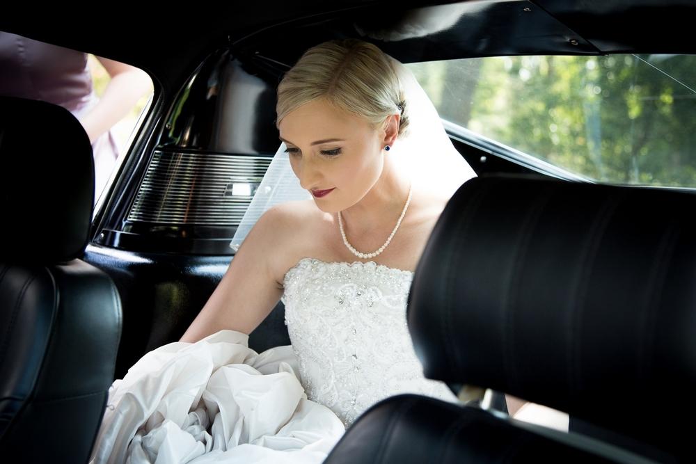 bride-back-seat-wedding-car.jpg