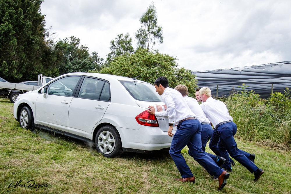 grooms-pushing-the-car.jpg