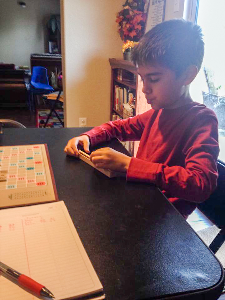 Joaquin about to place a seven-letter word.