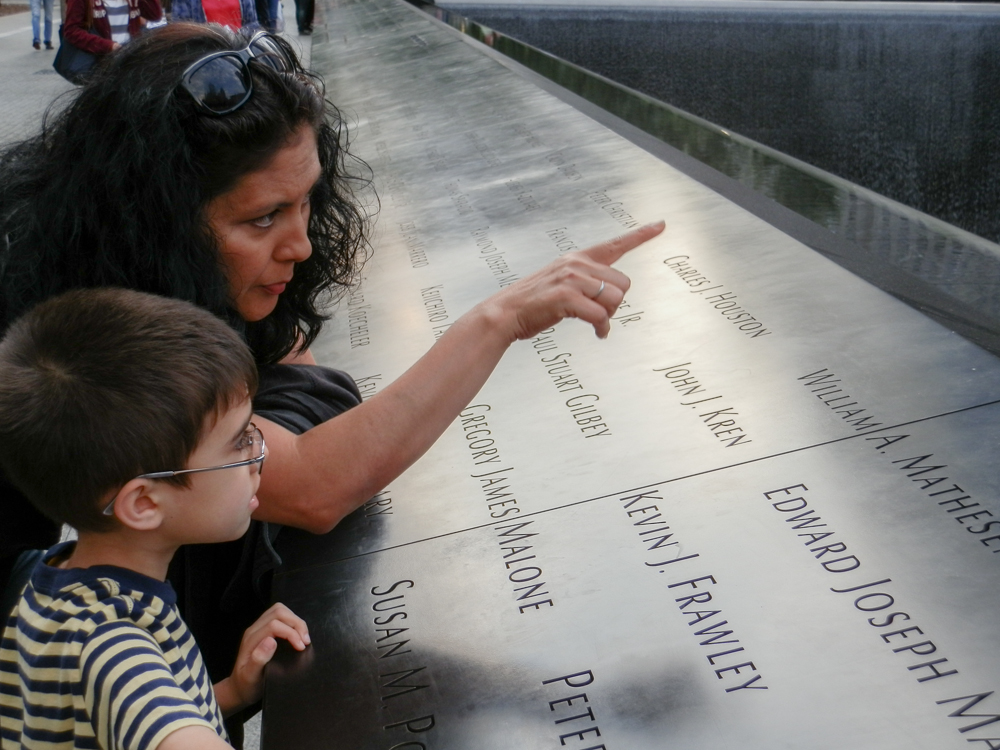 My mom teaching her youngest about the World Trade Center event, 2012