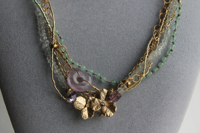 On Golden Pond (amethyst, aquamarine, jade, cubic zirconia, gold plated brass, silver thread, brass)