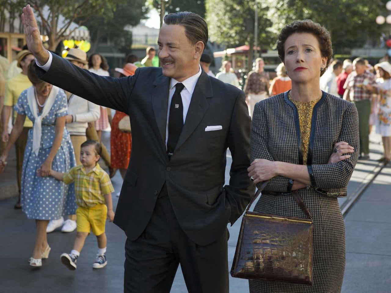 Saving Mr Banks (Film Review) 'Saving Mr Banks' tells the story of P.L. Travers (played by Emma Thompson), author of the novel 'Mary Poppins'. Legendary filmmaker Walt Disney (played by Tom Hanks) pulls out all the stops to get Travers to sign over the rights to adapt the story for a feature film. With the royalties from sales of the book dwindling to point that she won't be able to keep her house, Travers reluctantly agrees to spend two weeks at Disney's studios in California discussing ideas and plans for the adaptation. The character of P.L Travers at first glance is a difficult pill to take. Travers is a very demanding individual, asking for every meeting to be recorded on tape and at one point for the colour red to be completely removed from the film. Stubborn, distant and very little patience for tomfoolery, Disney has met his match especially considering the talks of making the adaptation started 20 years prior. The story at key points goes right back into Travers' childhood, showing how her past has formed her personality and the powerful bond to her literary creation. Slowly over time, you begin to understand why Travers acts the way she does and wonder what lengths Disney and his employees will go to get her on their side. I quite liked the subtle references to all things Disney with the classic musical themes hidden in the score to the many sightings of well-loved animated characters throughout the film. The 1960s style made famous by recent shows such as Mad Men, is prominent here, showcased in it's music and costuming, even showing off the Disneyland theme park just like how it was during that era. Featuring a stellar cast including Colin Farrell, Bradley Whitford and Paul Giamatti, this film is sure to inspire the fun-loving child in all of us.