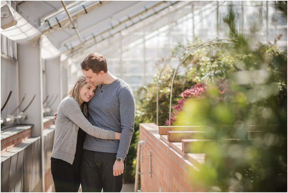 Engaged couple having fun in Matthaei Botanical Gardens.