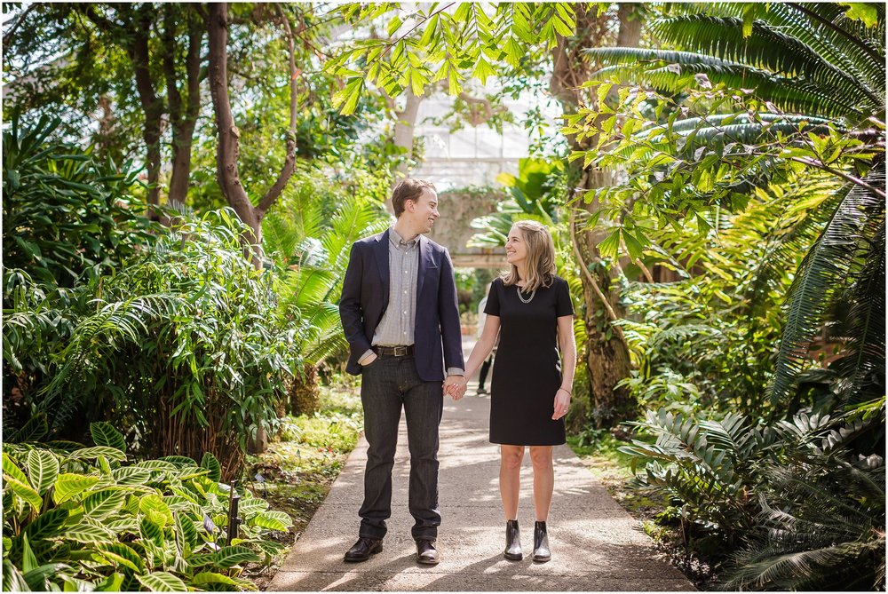 Fashionable couple holding hands in Matthaei Botanical Gardens Conservatory.