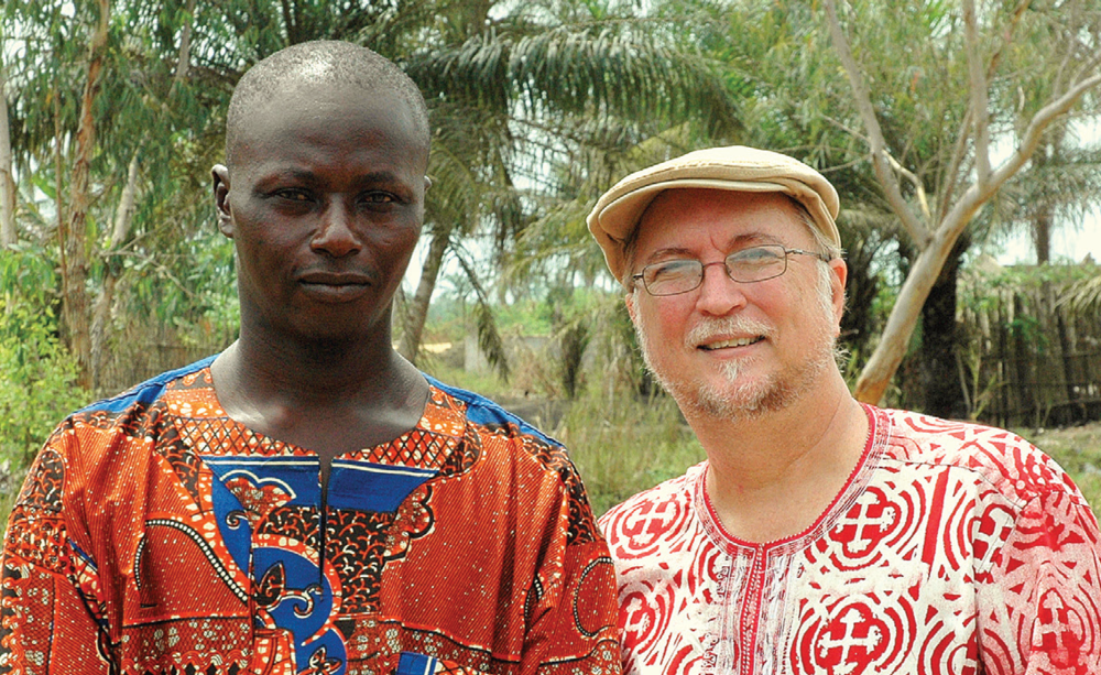 "Mike and Lynn Hutchinson help people in their community to discover their gifts, passions and assets that can lead to sustainable projects that lift them out of poverty and empower them to ""be who God designed them to be."" Mike (right) is pictured with a local pastor, Dominique (left), who shared ideas about how to reach out and impact his community."