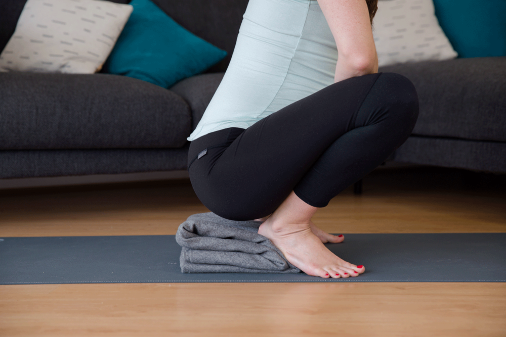 Squat heel life modification from The Yoga for Pregnant Athletes Collection