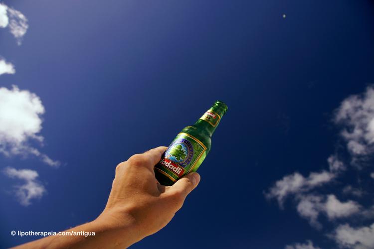 Wadadli beer and Antiguan sky - Darkwood beach