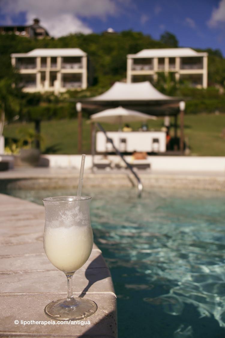 Pina colada at the pool of Sugar Ridge hotel, Antigua