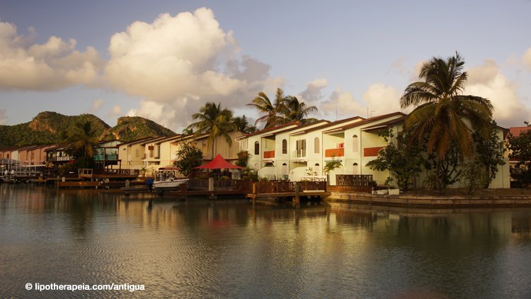 Villas on the waterfront at sunset, Jolly harbour, Antigua