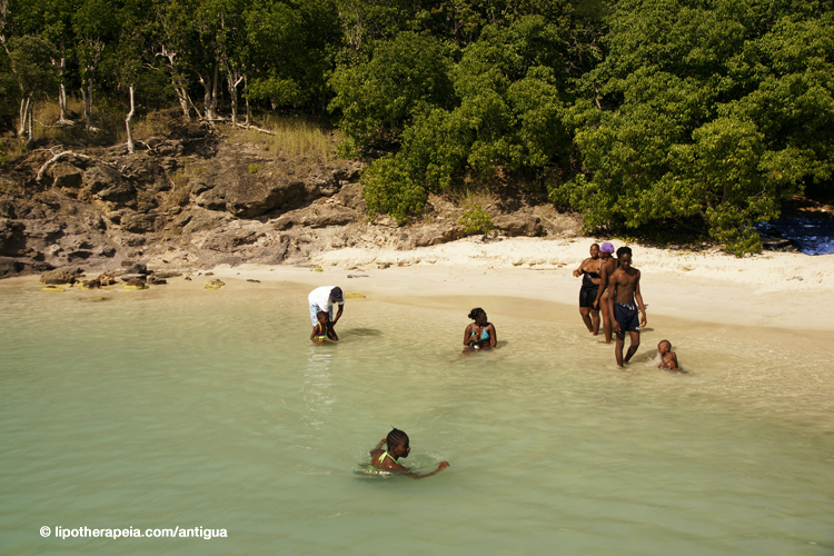 Antiguans enjoying Deep bay on national holiday
