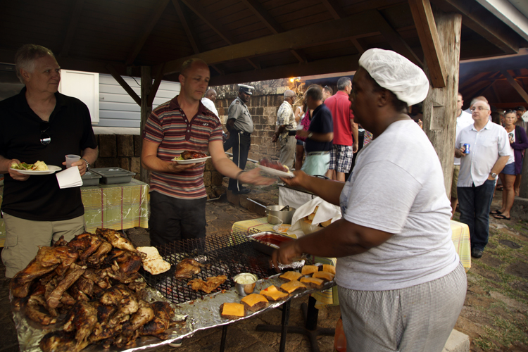 Antiguan mamma serving grilled food at Shirley Heights. Yum!