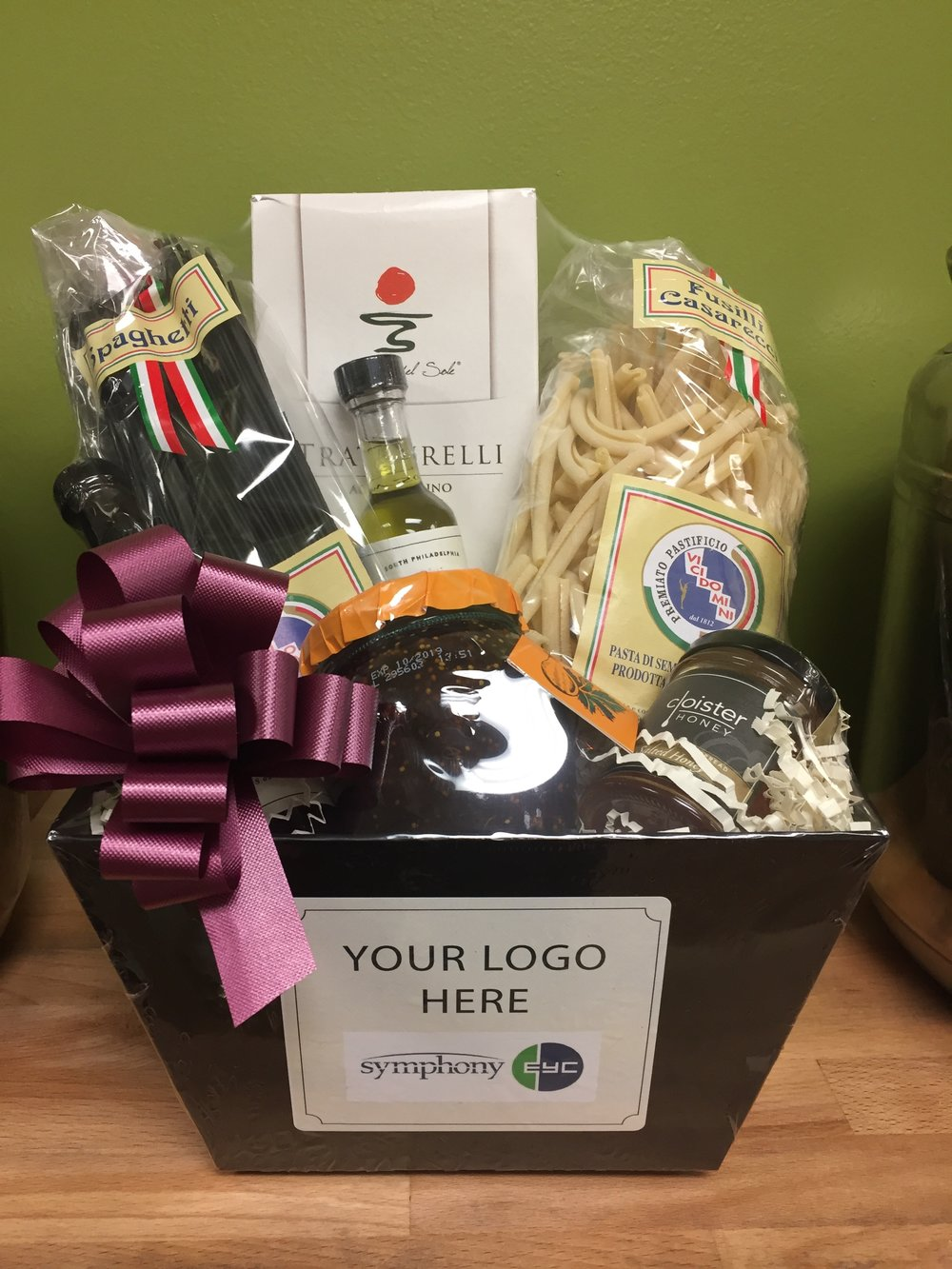 - We offer corporate gifts customized with your logo and message.Premium Italian Specialty Gift BasketFeatures: Extra Virgin Olive Oil, Traditional Balsamic, Pasta, Preserves, Honey, Rosemary BreadsticksCustom logos -Please email your logo file in .JPG or .EPS format to info@cardenastaproom.com.PRICE: $64.95 +shipping