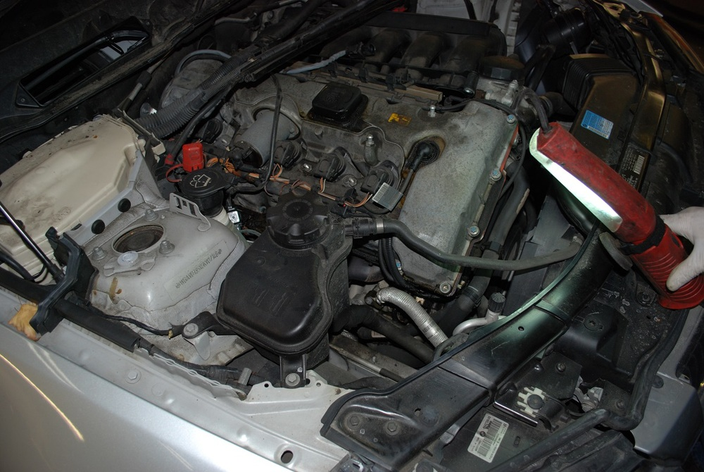 325xi oil leaks and starter.jpg