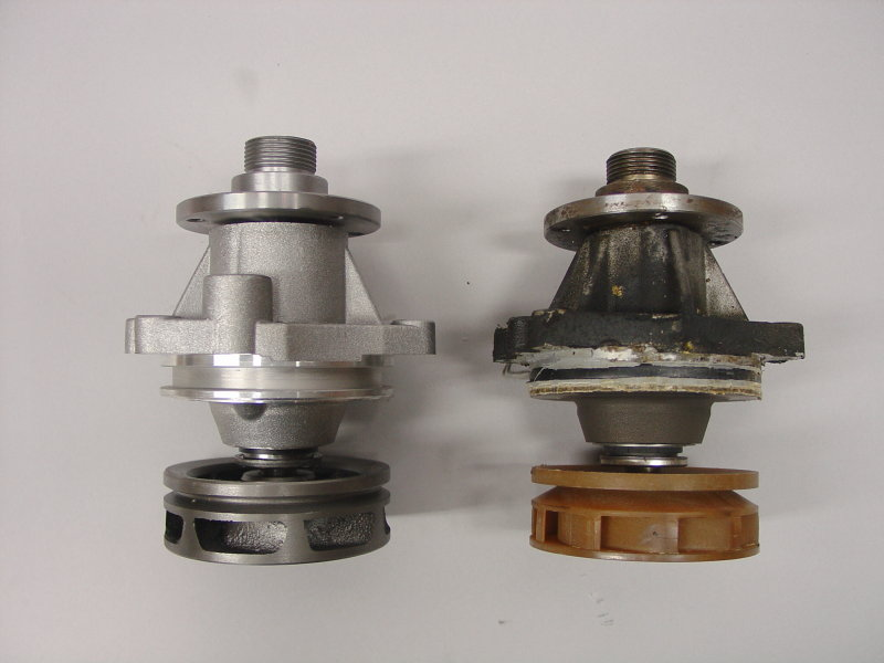 Two BMW style water pumps. On the left is the new part, with metal impeller, on the right is a used, worn out water pump with a plastic impeller, removed before excessive deterioration.