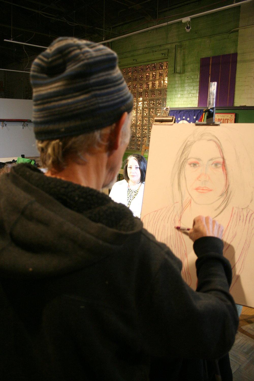 Larry Zuzik drawing Emily.