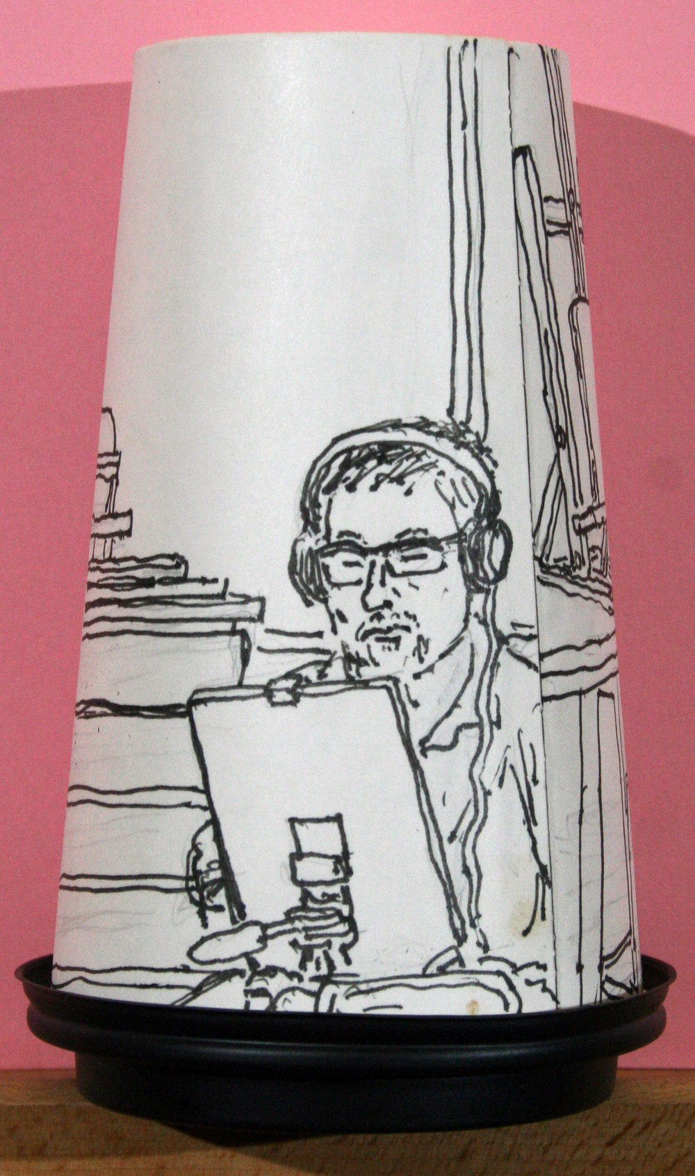 Portrait of Steve Sens on the back of Jack Flotte's coffee cup portrait of Arnette.