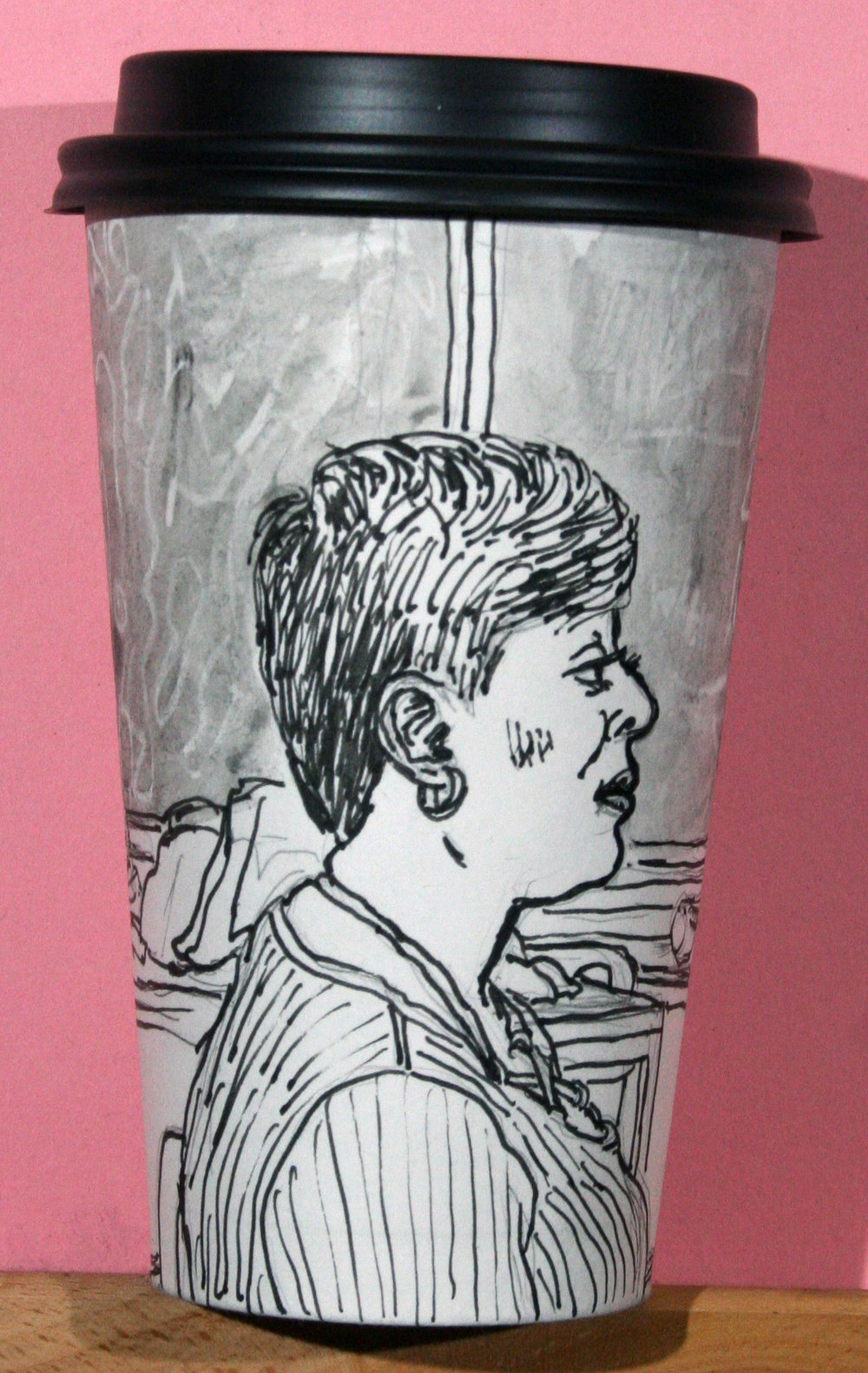 Jack Flotte did this ink and white China marker coffee cup portrait of Nette.