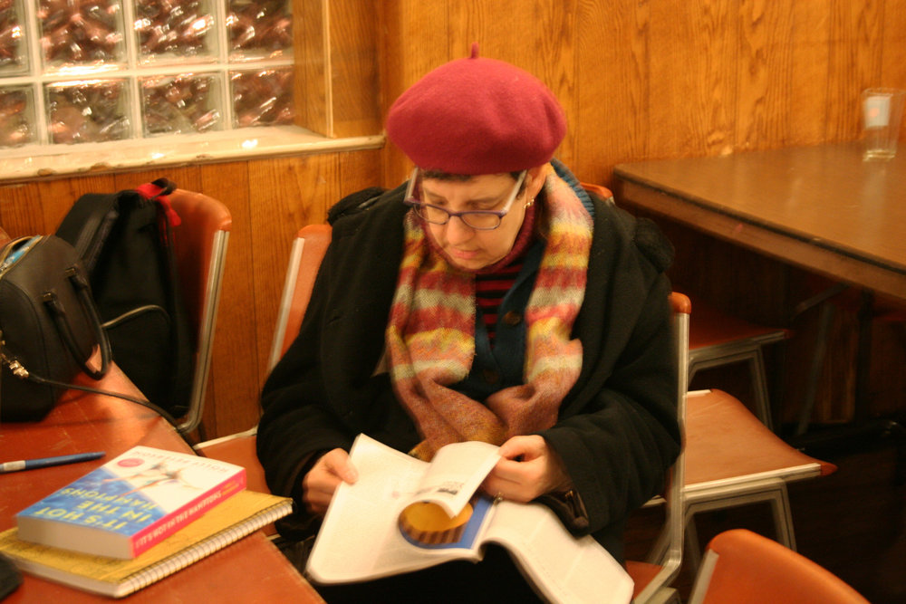 Kari Collier reading up! Photo by Anne Lyon.