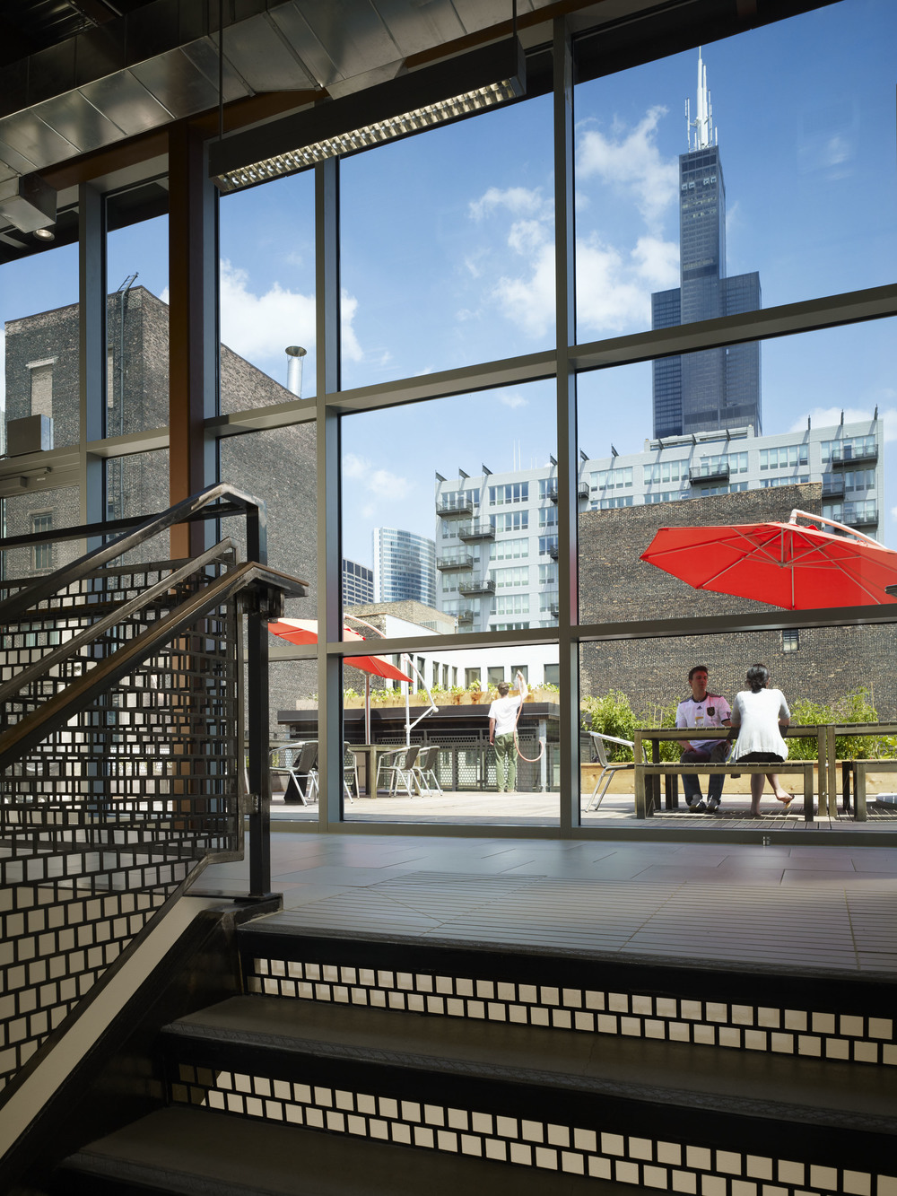This is one of my favorite spaces in the IDEO office: our roofdeck! It's a great sanity check to have some outdoor space in the middle of a busy work week. Bonus: during the summer we hold outdoor movie nights out there. Photo by Steve Hall (C) 2010 Hedrich Blessing Photography