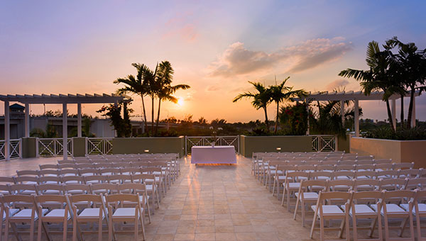 Along Florida's Intracoastal Waterway,  Wyndham Grand Jupiter 's Mangrove Deck overs stunning views along the water complete with picturesque sunsets and a palm tree-studded horizon. Groups can enjoy the Preserve Ballroom leading out to the deck, or the outdoor space alone.
