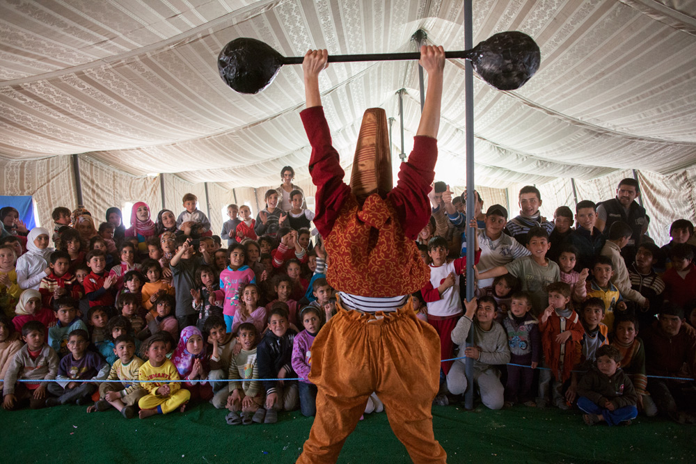 Mimi the Clown with Clowns Without Borders Ireland performs for Syrian children at Zaatari.