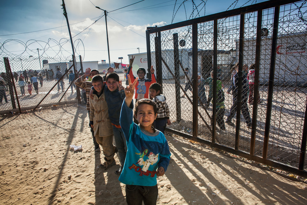Syrian boys at Zaatari camp make a peace sign as they leave a Clowns Without Borders Ireland performance.