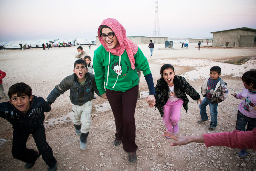 Sandra from Clowns Without Borders Ireland leads Syrian children in a performance activity workshop at Zaatari refugee camp.