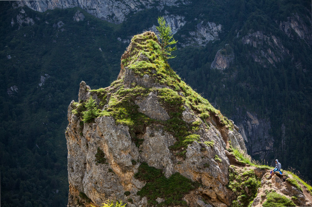A hiker rests at the top of the Via Ferrata in the Tarentaise valley near the border of the Vanoise park.