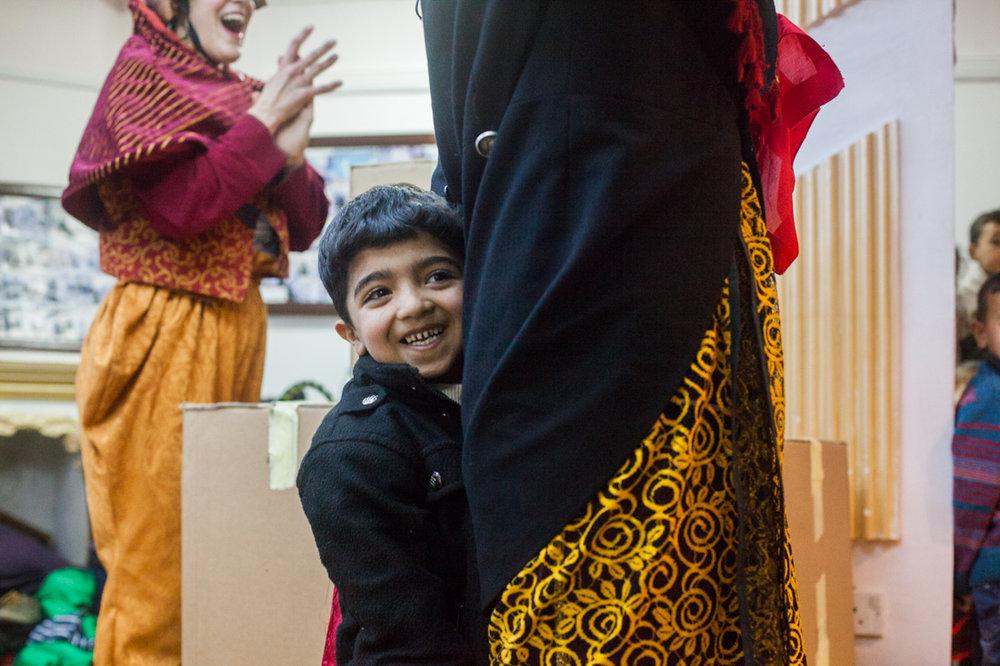A refugee boy's joy of being part of a clown show.